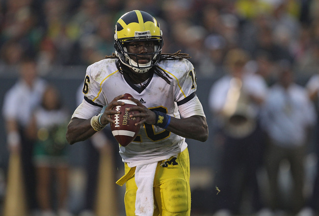 SOUTH BEND, IN - SEPTEMBER 11: Denard Robinson #16 of the Michigan Wolverines looks for a receiver against the Notre Dame Fighting Irish at Notre Dame Stadium on September 11, 2010 in South Bend, Indiana. Michigan defeated Notre Dame 28-24.  (Photo by Jon