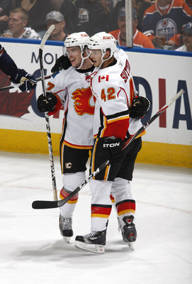 EDMONTON, CANADA - OCTOBER 1:  Jon Rheault #47 and Brett Sutter #42 of the Calgary Flames celebrate Rheault's goal in the third period at Rexall Place October 1, 2010 in Edmonton, Alberta, Canada. (Photo by Dale MacMillan/Getty Images)