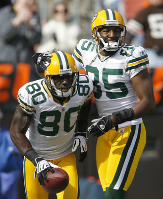 CLEVELAND, OH - OCTOBER 25:  Donald Driver #80 and Greg Jennings #85 of the Green Bay Packers celebrate after scoring a touchdown against the Cleveland Browns at Cleveland Browns Stadium on October 25, 2009 in Cleveland, Ohio.  (Photo by Matt Sullivan/Get
