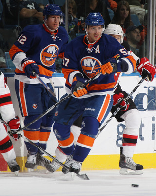 UNIONDALE, NY - OCTOBER 02: Blake Comeau #57 of the New York Islanders skates against the New Jersey Devils at the Nassau Veterans Memorial Coliseum on October 2, 2010 in Uniondale, New York. The Islanders defeated the Devils 2-1.  (Photo by Bruce Bennett