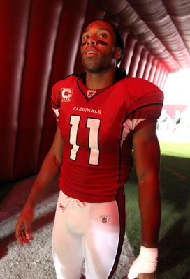 GLENDALE, AZ - SEPTEMBER 26:  Wide receiver Larry Fitzgerald #11 of the Arizona Cardinals waits to be introduced before the NFL game against the Oakland Raiders at the University of Phoenix Stadium on September 26, 2010 in Glendale, Arizona.  The Cardinal
