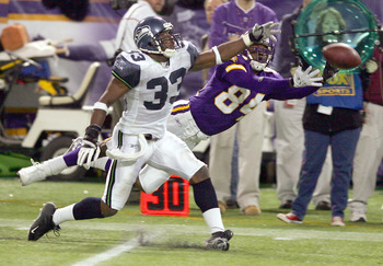 MINNEAPOLIS - DECEMBER 12: Marquand Manuel #33 of the Seattle Seahawks is called for pass interference on this play with Randy Moss #84 of the Minnesota Vikings on December 12, 2004 at the Hubert H. Humphrey Metrodome in Minneapolis, Minnesota. The Seattl