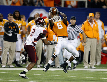 ATLANTA - DECEMBER 31:  Wide receiver Denarius Moore #6 of the Tennessee Volunteers hauls in a second quarter pass while defensive back Devon Morgan #2 of the Virginia Tech Hokies tries to cover him during the Chick-Fil-A Bowl at the Georgia Dome on Decem
