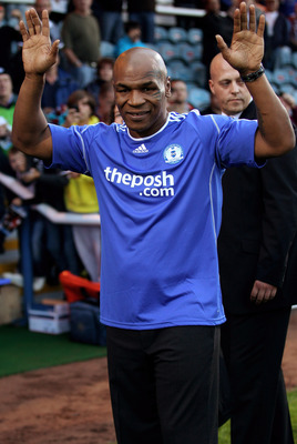 PETERBOROUGH, ENGLAND - JULY 14:   Boxing legend Mike Tyson puts in an appearance at half time during the pre-season friendly match between Peterborough United and  West Ham at London Road on July 14, 2010 in Peterborough, England.  (Photo by Mark Thompso