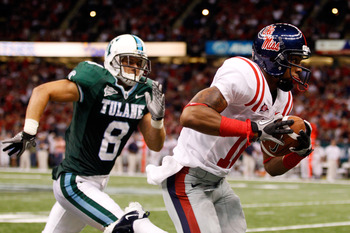 NEW ORLEANS - SEPTEMBER 11:  Markeith Summers #16 of the Ole Miss Rebels catches a pass over Alex Wacha #8 of the the Tulane Green Wave at the Louisiana Superdome on September 11, 2010 in New Orleans, Louisiana.  Ole Miss defeated Tulane 27-13.  (Photo by