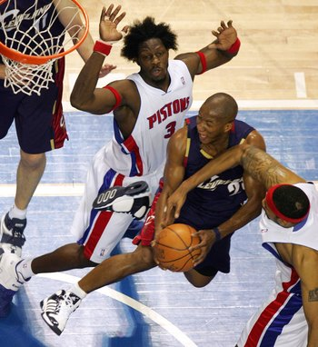 AUBURN HILLS, MI - MAY 21:  Eric Snow #20 of the Cleveland Cavaliers tries to get a shot off between Ben Wallace #3 and Rasheed Wallace #36 of the Detroit Pistons in game seven of the Eastern Conference Semifinals during the 2006 NBA Playoffs on May 21, 2