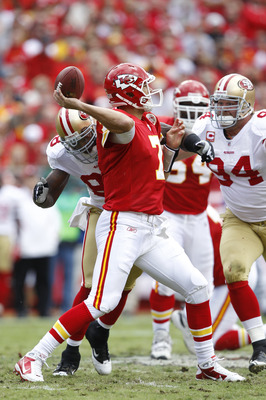 KANSAS CITY, MO - SEPTEMBER 26: Matt Cassel #7 of the Kansas City Chiefs passes the ball while under pressure from Justin Smith #94 and Parys Haralson #98 of the San Francisco 49ers at Arrowhead Stadium on September 26, 2010 in Kansas City, Missouri. The