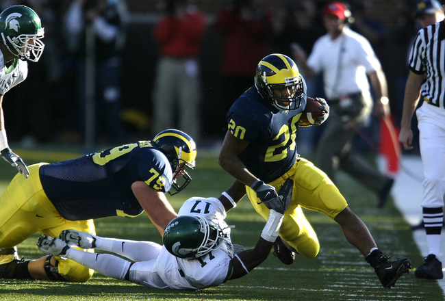 ANN ARBOR, MI - OCTOBER 30:  Running back Mike Hart #20 of the Michigan Wolverines rushes against the Michigan State Spartans at Michigan Stadium on October 30, 2004 in Ann Arbor, Michigan.  Michigan won the game, 45-37.  (Photo by Tom Pidgeon/Getty Image