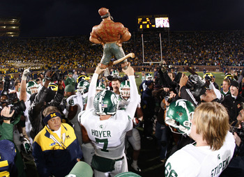 Michigan State quarterback Brian Hoyer hoists the Bunyan trophy Michigan State defeats Michigan 37-21 in the 2008 contest at Ann Arbor.after