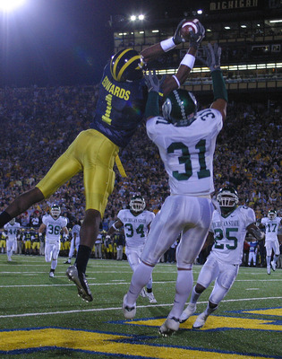 Michigan's Braylon Edwards grabs one of three TD catches in the 2004 overtime classic.classic.