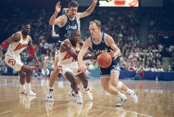 Oct 1993:  Guard Scott Skiles of the Orlando Magic (right) drives the ball down the court during a game against the Atlanta Hawks at Wembley Stadium in London, England. Mandatory Credit: Mike Cooper  /Allsport