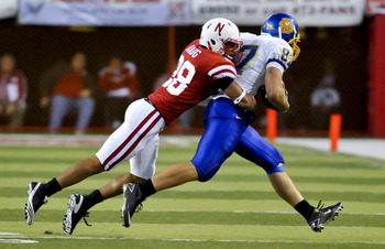 LINCOLN, NEBRASKA - SEPTEMBER 25: Nebraska Cornhuskers defensive back Eric Hagg #28 brings down South Dakota State Jackrabbits tight end Colin Cochart #87 during their game at Memorial Stadium on September 25, 2010 in Lincoln, Nebraska. Nebraska Defeated