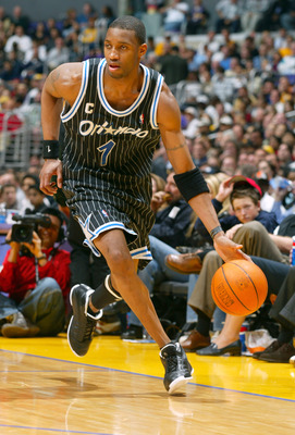 LOS ANGELES - MARCH 15:  Tracy McGrady #1 of the Orlando Magic drives upcourt during the game against the Los Angeles Lakers at Staples Center on March 15, 2004 in Los Angeles, California.  The Lakers won 113-110.   NOTE TO USER: User expressly acknowledg