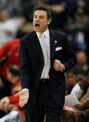 JACKSONVILLE, FL - MARCH 19:  Rick Pitino head coach of the Louisville Cardinals yells out to his team while facing the California Golden Bears during the first round of the 2010 NCAA men's basketball tournament at Jacksonville Veteran's Memorial Arena on