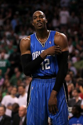 BOSTON - MAY 28:  Dwight Howard of the Orlando Magic looks on against the Boston Celtics in Game Six of the Eastern Conference Finals during the 2010 NBA Playoffs at TD Garden on May 28, 2010 in Boston, Massachusetts.  NOTE TO USER: User expressly acknowl