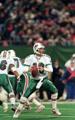 12 Dec 1999:  Dan Marino #13 of the Miami Dolphins gets ready to pass the ball during the game against the New York Jets at the Meadowlands in East Rutherford, New Jersey. The Jets defeated the Dolphins 28-20. Mandatory Credit: Al Bello  /Allsport