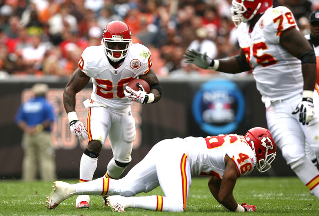 CLEVELAND - SEPTEMBER 19:  Running back Thomas Jones #20 of the Kansas City Chiefs gets a block from Tim Castille #46 and Branden Albert #76 against the Cleveland Browns at Cleveland Browns Stadium on September 19, 2010 in Cleveland, Ohio.  (Photo by Matt