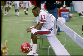 2 Dec 1989: Quarterback Andre Ware #11 of the Houston Cougars looks on during a game against the Rice Owls in Houston, Texas. The Houston Cougars won the game 64-0.