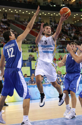 BEIJING - AUGUST 20:  Manu Ginobili #5 of Argentina drives to the basket over the defense of Konstantinos Tsartsaris #12 of Greece during the men's basketball quarterfinal game at the Olympic Basketball Gymnasium during Day 12 of the Beijing 2008 Olympic