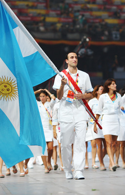 BEIJING - AUGUST 08:  Manu Ginobili of the Argentina Olympic men's basketball team carries his country's flag to lead out the delegation during the Opening Ceremony for the 2008 Beijing Summer Olympics at the National Stadium on August 8, 2008 in Beijing,