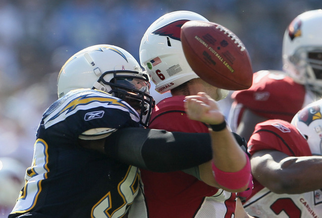 SAN DIEGO - OCTOBER 03:  Kevin Burnett #99 of the San Diego Chargers sacks quarterback Max Hall #6 of the Arizona Cardinals resulting in a fumble during the third quarter at Qualcomm Stadium on October 3, 2010 in San Diego, California. The Chargers defeat