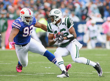 ORCHARD PARK, NY - OCTOBER 03: Brad Smith #16  of the New York Jets runs around Alex Carrington #92 of the Buffalo Bills at Ralph Wilson Stadium on October 3, 2010 in Orchard Park, New York.  (Photo by Rick Stewart/Getty Images)