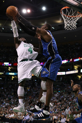 BOSTON - MAY 28:  Nate Robinson #4 of the Boston Celtics has his shot attempt blocked by Dwight Howard #12 of the Orlando Magic in Game Six of the Eastern Conference Finals during the 2010 NBA Playoffs at TD Garden on May 28, 2010 in Boston, Massachusetts