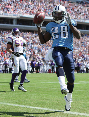 NASHVILLE, TN - SEPTEMBER 28:  Running back Chris Johnson #28 of the Tennessee Titans celebrates as he scores a touchdown past linebacker Chad Greenway #52 of the Minnesota Vikings at LP Field on September 28, 2008 in Nashville, Tennessee. The Titans defe