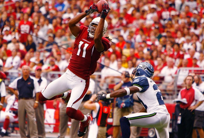 GLENDALE, AZ - SEPTEMBER 16:   Larry Fitzgerald #11 of the Arizona Cardinals leaps high to grab a pass against the Seattle Seahawks at University of Phoenix Stadium on September 16, 2007 in Glendale, Arizona.  The Cardinals defeated the Seahawks 23-20.  (