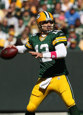 GREEN BAY, WI - OCTOBER 03: Aaron Rodgers #12 of the Green Bay Packers throws a pass against the Detroit Lions at Lambeau Field on October 3, 2010 in Green Bay, Wisconsin. The Packers defeated the Lions 28-26. (Photo by Jonathan Daniel/Getty Images)