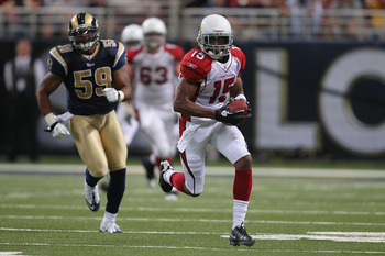 ST. LOUIS - SEPTEMBER 12: Steve Breaston #15 of the Arizona Cardinals runs up field against Larry Grant #59 of the St. Louis Rams during the NFL season opener at the Edward Jones Dome on September 12, 2010 in St. Louis, Missouri.  The Cardinals beat the R