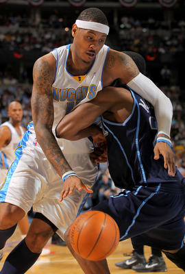 DENVER - APRIL 28:  Carmelo Anthony #15 of the Denver Nuggets tries to drive around Wesley Matthews #23 of the Utah Jazz in Game Five of the Western Conference Quarterfinals of the 2010 NBA Playoffs at the Pepsi Center on April 28, 2010 in Denver, Colorad