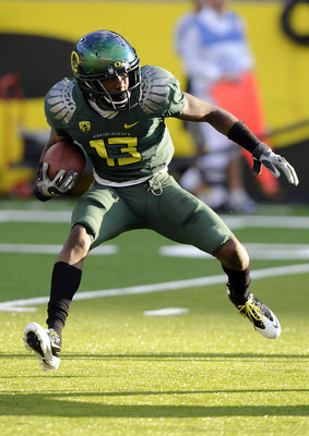EUGENE, OR - OCTOBER 2: Cornerback Cliff Harris #13 of the Oregon Ducks runs back a kick off in the first quarter of the game against the Stanford Cardinal at Autzen Stadium on October 2, 2010 in Eugene, Oregon. Oregon won the game 52-31. (Photo by Steve