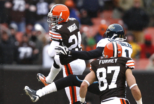 CLEVELAND - JANUARY 03:  Eric Wright #24 of the Cleveland Browns interceptions the ball in front of teammates Mike Furrey #87 and Mike Sims-Walker #11 of the Jacksonville Jaguars at Cleveland Browns Stadium on January 3, 2010 in Cleveland, Ohio.  (Photo b