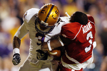 BATON ROUGE, LA - NOVEMBER 28:  Chad Jones #3 of the LSU Tigers knocks off the helmet of Joe Adams #3 of the Arkansas Razorbacks at Tiger Stadium on November 28, 2009 in Baton Rouge, Louisiana.  The Tigers defeated the Razorbacks 33-30 in overtime.   (Pho