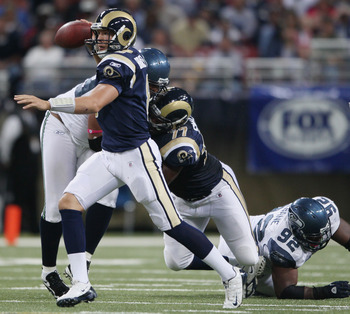ST. LOUIS - OCTOBER 03:  Sam Bradford #8 of the St. Louis Rams scrambles as he passes the ball in first half against the Seattle Seahawks on October 3, 2010 at Edward Jones Dome in St. Louis, Missouri.  (Photo by Elsa/Getty Images)