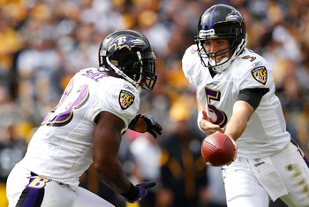 PITTSBURGH - OCTOBER 03:  Joe Flacco #5 of the Baltimore Ravens hands the ball off to teammate Willis McGahee #23 during the game against the Pittsburgh Steelers on October 3, 2010 at Heinz Field in Pittsburgh, Pennsylvania.  (Photo by Jared Wickerham/Get