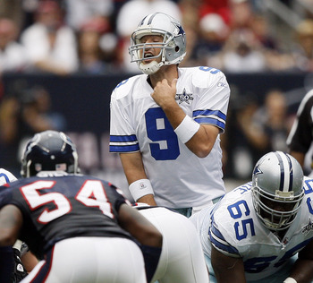 HOUSTON - SEPTEMBER 26:  Quarterback Tony Romo #9 of the Dallas Cowboys makes an adjustment at the line of scrimmage against the Houston Texans at Reliant Stadium on September 26, 2010 in Houston, Texas.  (Photo by Bob Levey/Getty Images)