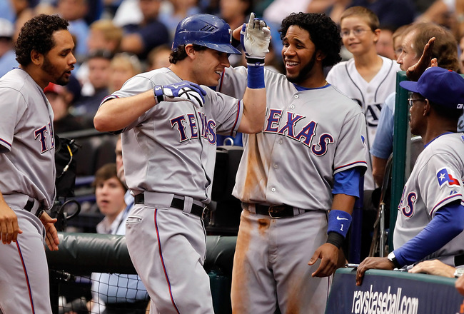 ST. PETERSBURG - OCTOBER 07:  Infielder Ian Kinsler #5 of the Texas Rangers is congratulated by Elvis Andrus #1 after his home run against the Tampa Bay Rays during Game 2 of the ALDS at Tropicana Field on October 7, 2010 in St. Petersburg, Florida.  (Pho