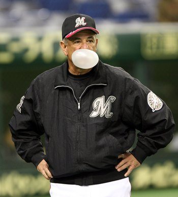 TOKYO - MARCH 1:  Team Manager Bobby Valentine of the Chiba Lotte Marines blows a bubble during the 2006 World Baseball Classic Exhibition Game against Korea on March 1, 2006 at Tokyo Dome in Tokyo, Japan. The exhibition games in Tokyo take place between