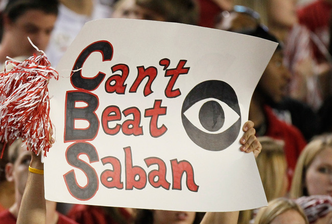 TUSCALOOSA, AL - OCTOBER 02:  A fan of the Alabama Crimson Tide holds up a sign about head coach Nick Saban during the game against the Florida Gators at Bryant-Denny Stadium on October 2, 2010 in Tuscaloosa, Alabama.  (Photo by Kevin C. Cox/Getty Images)