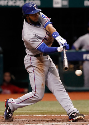ST. PETERSBURG, FL - OCTOBER 06:  Shortstop Elvis Andrus #1 of the Texas Rangers fouls off a pitch against the Tampa Bay Rays during Game 1 of the ALDS at Tropicana Field on October 6, 2010 in St. Petersburg, Florida.  (Photo by J. Meric/Getty Images)