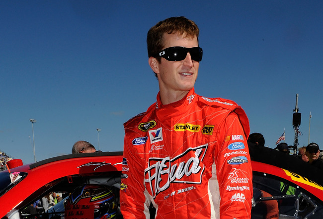 KANSAS CITY, KS - OCTOBER 03:  Kasey Kahne, driver of the #9 Budweiser Ford, stands on pit road prior to the NASCAR Sprint Cup Series Price Chopper 400 on October 3, 2010 in Kansas City, Kansas.  (Photo by John Harrelson/Getty Images)
