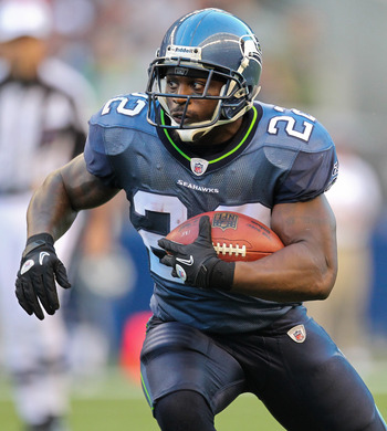 SEATTLE - AUGUST 14:  Running back Julius Jones #22 of the Seattle Seahawks rushes during the preseason game against the Tennessee Titans at Qwest Field on August 14, 2010 in Seattle, Washington. (Photo by Otto Greule Jr/Getty Images)