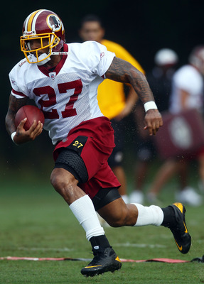 ASHBURN, VA - JULY 29:  Running back Larry Johnson #27 of the Washington Redskins carries the ball during drills on the first day of training camp July 29, 2010 in Ashburn, Virginia.  (Photo by Win McNamee/Getty Images)