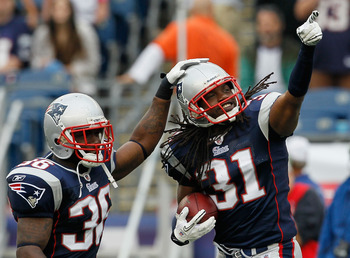 FOXBORO, MA - SEPTEMBER 26:  Brandon Meriweather  #31 of the New England Patriots reacts with teammate James Sanders #36 after Meriweather intercepted a pass against the Buffalo Bills in the second half at Gillette Stadium on September 26, 2010 in Foxboro