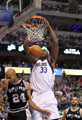 DALLAS - APRIL 21:  Center Brendan Haywood #33 fo the Dallas Mavericks makes the slam dunk in front of Richard Jefferson #24 of the San Antonio Spurs in Game Two of the Western Conference Quarterfinals during the 2010 NBA Playoffs at American Airlines Cen