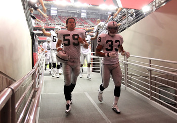GLENDALE, AZ - SEPTEMBER 26:  (L-R) Jon Condo #59 and Tyvon Branch #33 of the Oakland Raiders before the NFL game against the Arizona Cardinals at the University of Phoenix Stadium on September 26, 2010 in Glendale, Arizona.  The Cardinals defeated the Ra