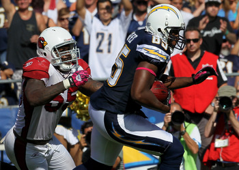 SAN DIEGO - OCTOBER 03:  Tight end Antonio Gates #85 of the San Diego Chargers carries the ball against linebacker Joey Porter #55 of the Arizona Cardinals at Qualcomm Stadium on October 3, 2010 in San Diego, California.  The Chargers won 41-10.  (Photo b
