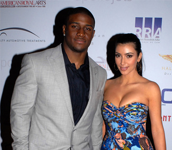 99276_reggie-bush-and-kim-kardashian-in-st-petersburg-fla-prior-to-the-2009-super-bowl_display_image